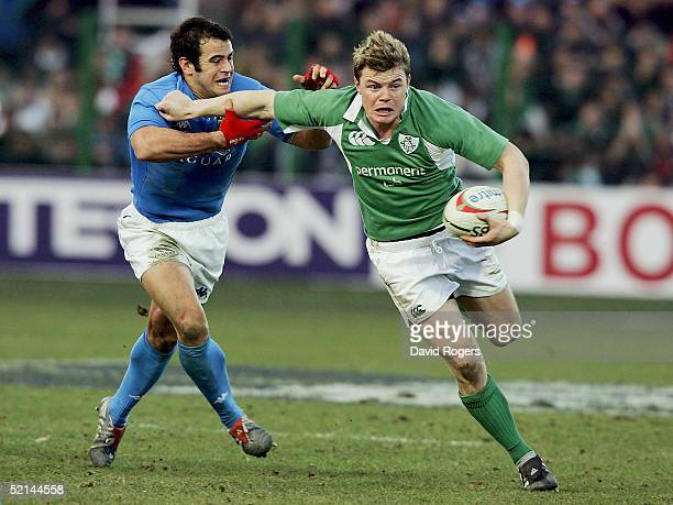 Captain of Ireland, Brian O'Driscoll charges forward as he is tackled by Gonzalo Canale of Italy during the RBS Six Nations Match between Italy and...