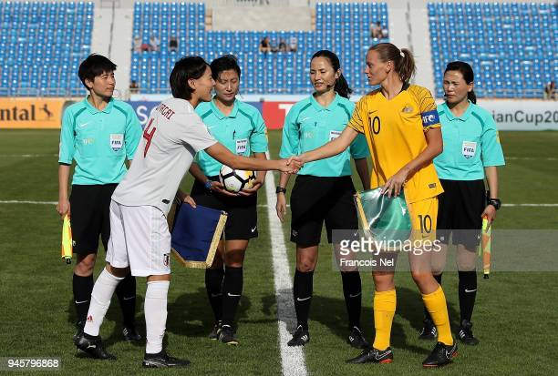 Captain of Japan Saki Kumagai and captain of Australia Emily VanEgmond shake hands prior to the AFC Women's Asian Cup Group B match between Japan and...
