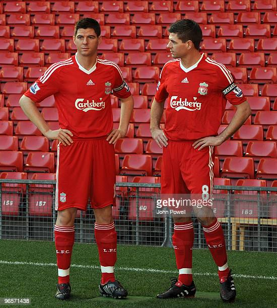 Captain of Liverpool FC Steven Gerrard unveils his new Madame Tussauds waxwork figure on the famous pitch at Anfield on February 11 2010 in Liverpool...