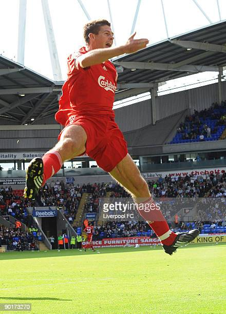 Captain of Liverpool Steven Gerrard celebrates scoring the third goal for Liverpool during the Barclays Premier League match between Bolton Wanderers...