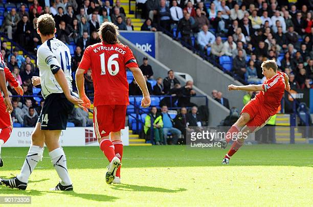 Captain of Liverpool Steven Gerrard scores the third goal for Liverpool during the Barclays Premier League match between Bolton Wanderers and...