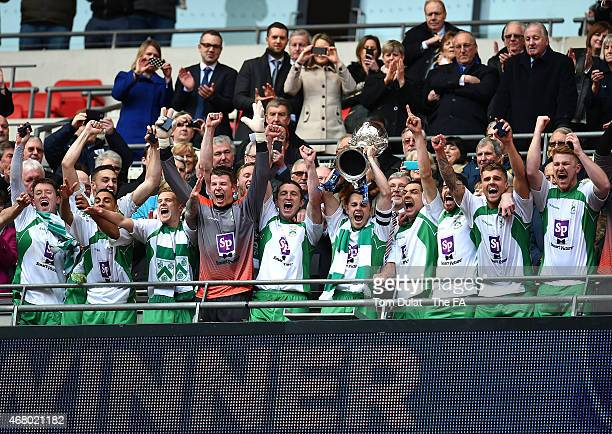 Captain of North Ferriby United Liam King lifts the trophy during the The FA Carlsberg Trophy Final between North Ferriby United and Wrexham at...