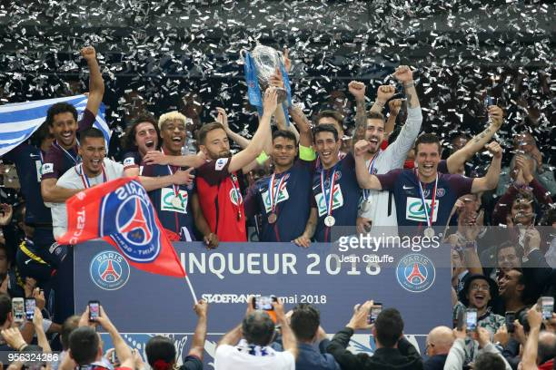 Captain of PSG Thiago Silva holds the trophy with captain of Les Herbiers Sebastien Flochon during the trophy ceremony following the French Cup final...