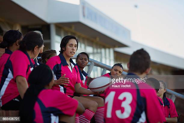Captain of rugby team explaining strategy