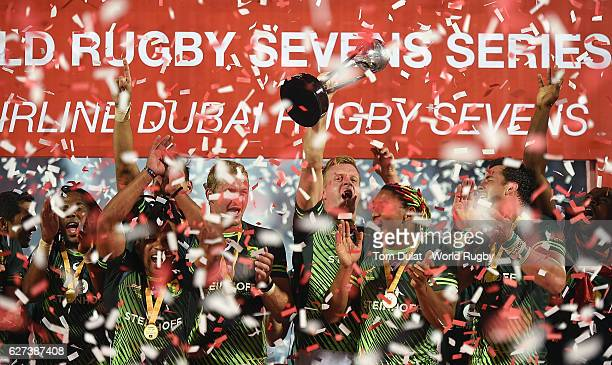 Captain of South Africa Dylan Sage lifts the trophy as the players celebrate winning the Emirates Dubai Rugby Sevens HSBC Sevens World Series Cup...