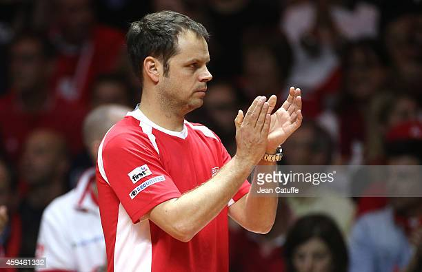 Captain of Switzerland Severin Luthi reacts during day three of the Davis Cup tennis final between France and Switzerland at the Grand Stade Pierre...
