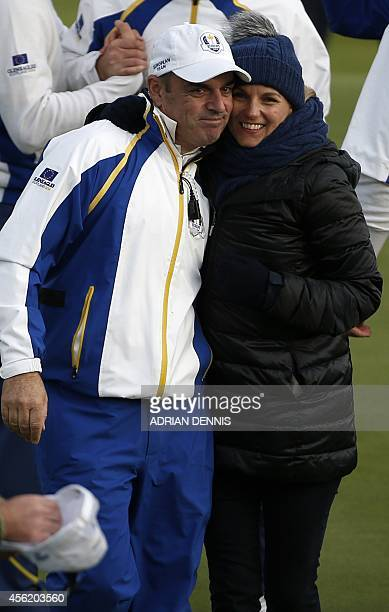 Captain of Team Europe Paul McGinley of Ireland and his wife Allison McGinley leave the 18th green after Saturday's foursomes matches at Gleneagles...