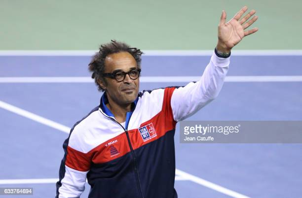 Captain of Team France Yannick Noah celebrates winning the doubles match and the tie 3-0 on day 2 of the Davis Cup World Group first round tie...