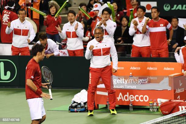 Captain of Team Japan Minoru Ueda cheers on his player during the Davis Cup by BNP Paribas first round doubles match between Japan and France at...
