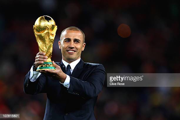 Captain of the 2006 FIFA World Cup winning team Fabio Cannavaro presents the World Cup on the pitch ahead of the 2010 FIFA World Cup South Africa...