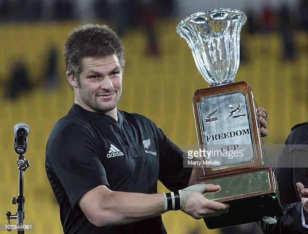Captain of the All Blacks Richie McCaw holds the 'Freedom Cup' after the TriNations match between the New Zealand All Blacks and South African...