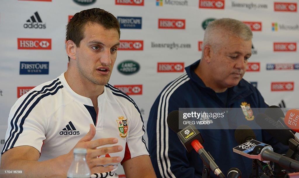 Captain of the British and Irish Lions rugby union team Sam Warburton (L) speaks as coach Warren Gatland (R) listens during a team announcement press conference in Sydney on June 13, 2013. The Lions will face the New South Wales Waratahs in a tour match in Sydney on June 15. IMAGE STRICTLY RESTRICTED TO EDITORIAL USE - STRICTLY NO COMMERCIAL USE --- AFP PHOTO / Greg WOOD