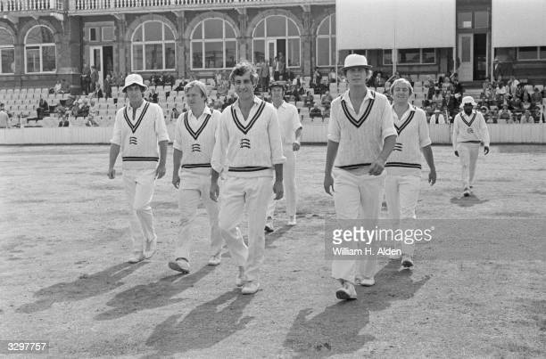 Captain of the Middlesex cricket club T M Breakley leads his team onto the field at the Oval