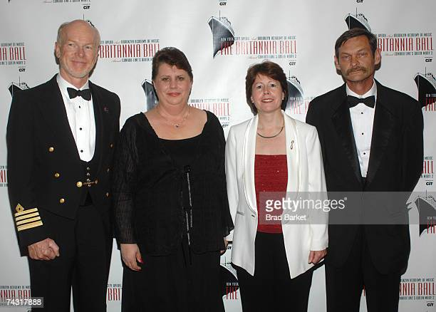 Captain of the Queen Mary II Chris Rynd Roxanne Neukam Carol Marlow and Marvin Neukam attend the Britannia Ball at the Brooklyn Cruise Terminal on...