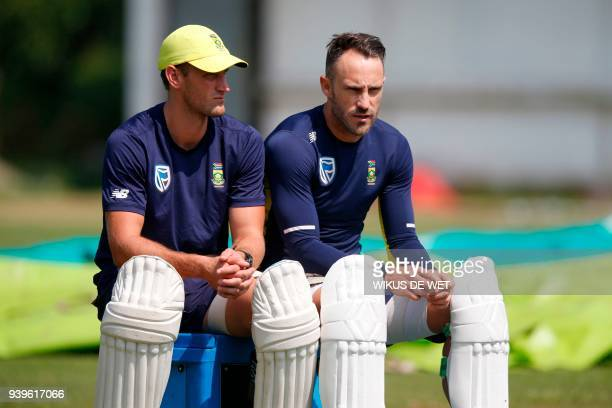 Captain of the South African cricket team Faf du Plessis and cricketer Theunis de Bruyn take a break during a team practice session on March 29 2018...