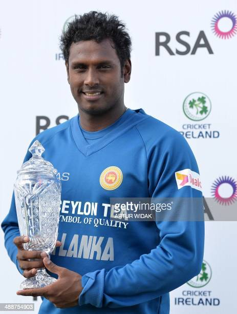 Captain of the Sri Lankan Cricket Team Angelo Mathews poses with the Trophy at the Clontarf Cricket Club Ground in Dublin on May 8 after the second...