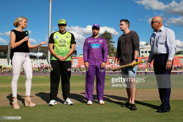 Captain of the Thunder Shane Watson and captain of the Hurricanes Matthew Wade at the bat toss prior to the Big Bash League match between the Sydney...