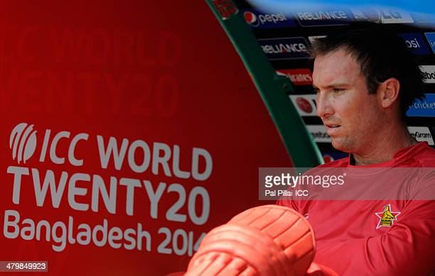 Captain of Zimbabwe Brendan Taylor sits in the dugout during the ICC T20 World Cup match between Zimbabwe and UAE at Sylhet International Cricket...