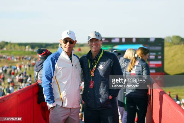 Captain Padraig Harrington of Ireland and team Europe and captain Steve Stricker of team United States pose for a photo during Friday Morning...
