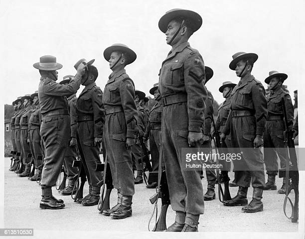 Captain Pahalman Gurung inspects a contingent of Gurkhas stationed at the Warminster School of Infantry The Gurkhas which form part of the...