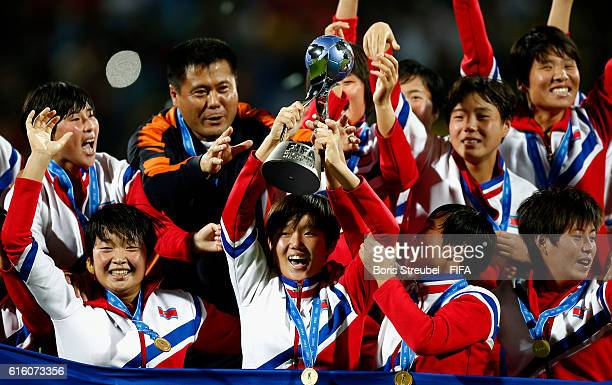 Captain Pak Hye Gyong of Korea DPR lifts the trophy as the team of Korea DPR celebrate winning the world cup after the FIFA U17 Women's World Cup...