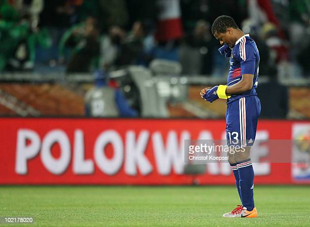 Captain Patrice Evra of France looks dejected after suffering defeat to Mexico during the 2010 FIFA World Cup South Africa Group A match between...