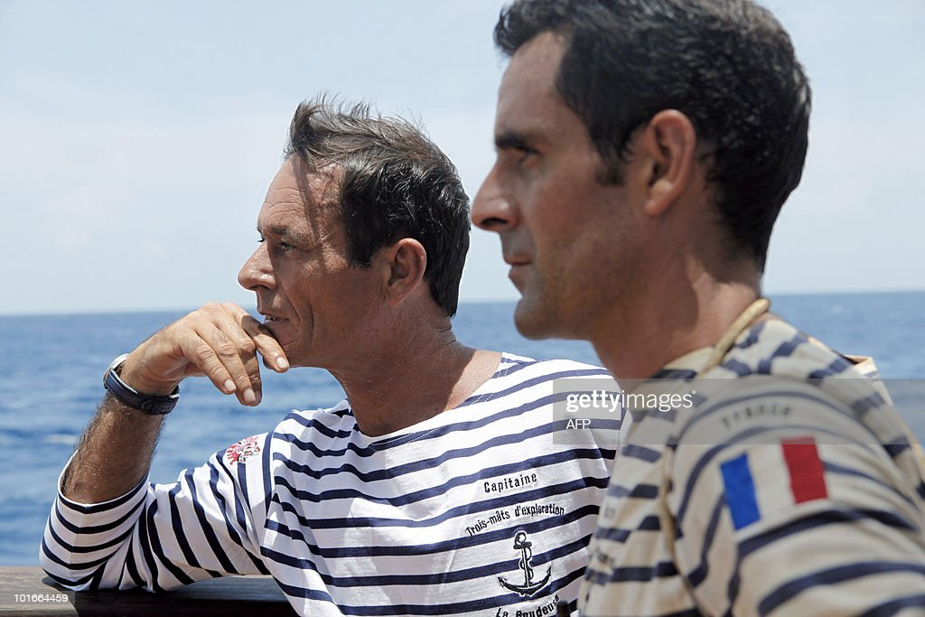 Captain Patrice Franceschi (L) and crew member Paul Le Cann stand aboard the French schooner La Boudeuse sailing off the coast of the city of Fort-de-France in the French Caribbean island of Martinique, on June 6, 2010. The three masted ship left the harbour of Fecamp in Brittany last November for a two-year scientific expedition entitled 'Terre-Ocean' (Earth Ocean) from South America to the Pacific Ocean. Patrice Franceschi announced on June 4, 2010 that the expedition around the world of La Boudeuse will end shortly due to lack of funds and that the ship will be sold soon in Martinique.