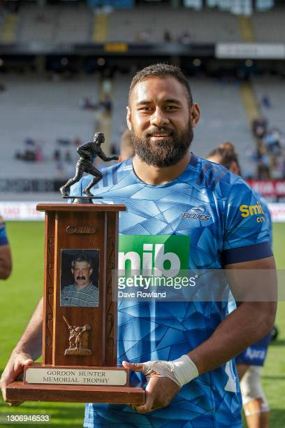 Captain Patrick Tuipulotu of the Blues with the Gordon Hunter Memorial Trophy after victory in the round three Super Rugby Aotearoa match between the...