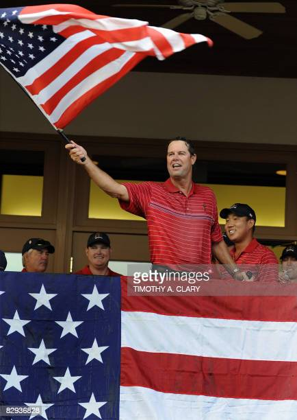 Captain Paul Azinger of the United States celebates after Team USA defeated Europe 16 1/2 to 11/12 at the 37th Ryder Cup at Valhalla Golf Club in...