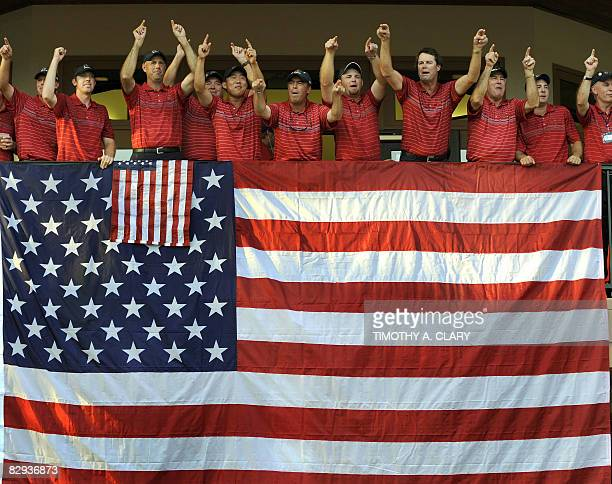 Captain Paul Azinger of the United States celebates with his team after Team USA defeated Europe 16 1/2 to 11 1/2 at the 37th Ryder Cup at Valhalla...