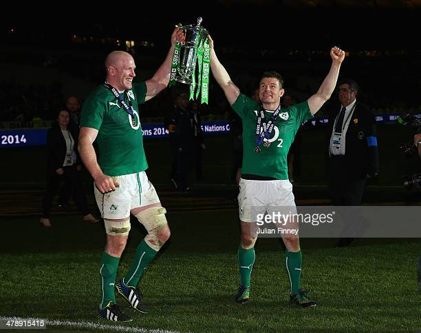Captain Paul O'Connell of Ireland and Brian O'Driscoll celebrate with the Six Nations Championship during the RBS Six Nations match between France...