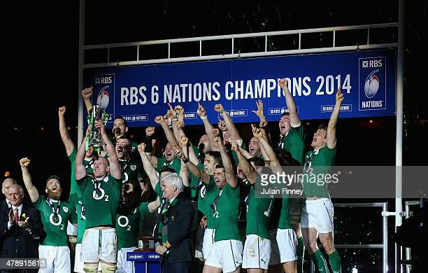 Captain, Paul O'Connell of Ireland and team mates celebrate with the Six Nations Championship trophy during the RBS Six Nations match between France...