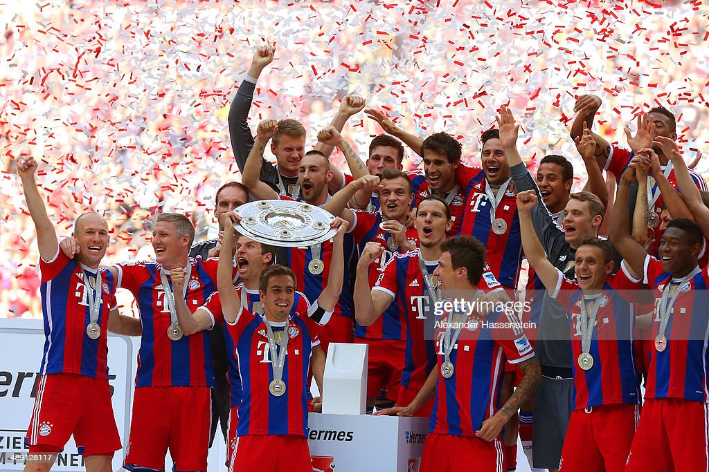 Captain Philipp Lahm of Bayern Muenchen lifts the Bundesliga championship trophy in celebration after the Bundesliga match between Bayern Muenchen and VfB Stuttgart at Allianz Arena on May 10, 2014 in Munich, Germany.