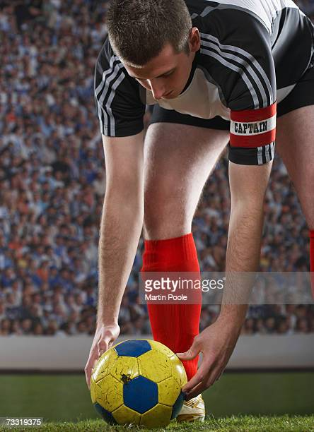 captain positioning  soccer ball on field - team captain stock pictures, royalty-free photos & images