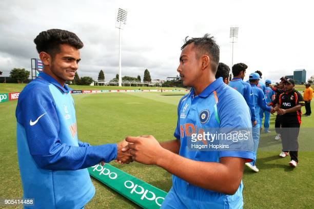 Captain Prithvi Shaw and Kamlesh Nagarkoti of India shake hands at the conclusion of the ICC U19 Cricket World Cup match between India and Papua New...