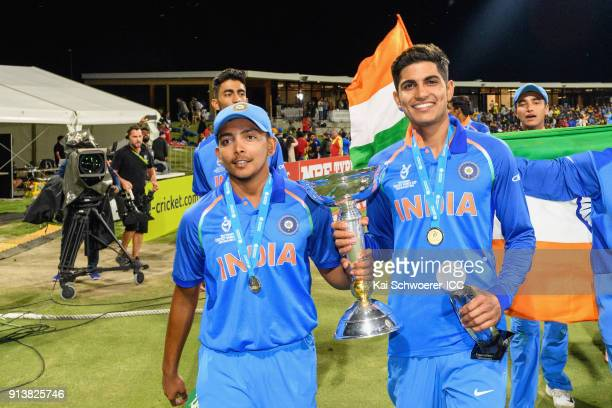 Captain Prithvi Shaw and Shubman Gill of India hold the trophy after the win in the ICC U19 Cricket World Cup Final match between Australia and India...
