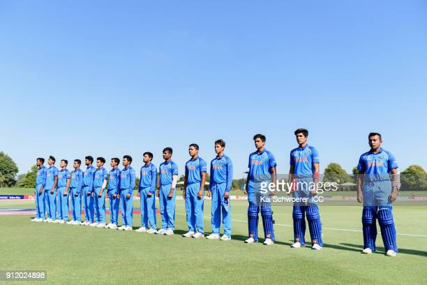 Captain Prithvi Shaw of India and his team mates line up for their national anthem prior to the ICC U19 Cricket World Cup Semi Final match between...