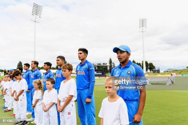 Captain Prithvi Shaw of India and his team mates line up for their national anthem prior to the ICC U19 Cricket World Cup Final match between...