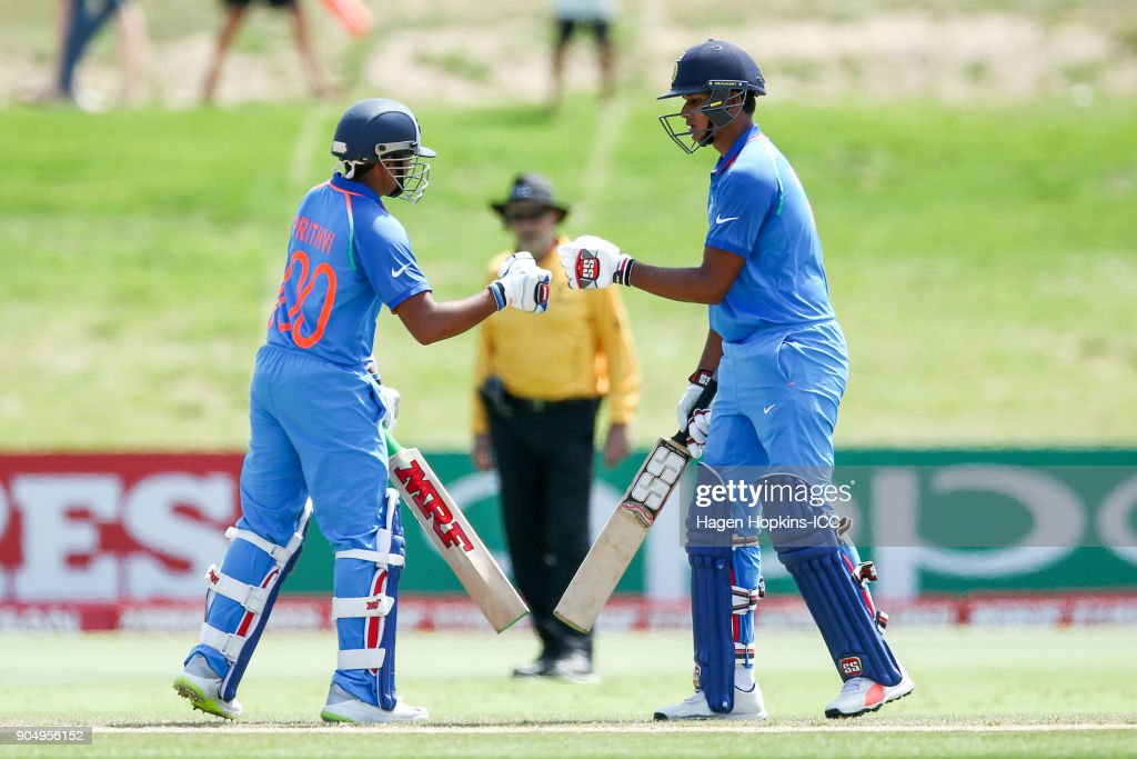 Captain Prithvi Shaw of India and Manjot Kalra of India bump fists during the ICC U19 Cricket World Cup match between India and Australia at Bay Oval on January 14, 2018 in Tauranga, New Zealand.