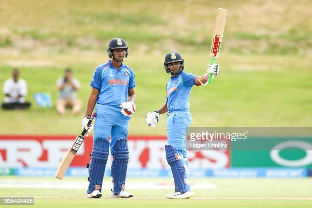 Captain Prithvi Shaw of India celebrates his half century with teammate Manjot Kalra of India during the ICC U19 Cricket World Cup match between...