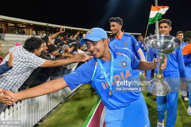 Captain Prithvi Shaw of India greets fans while he holds the trophy after the win in the ICC U19 Cricket World Cup Final match between Australia and...