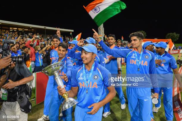 Captain Prithvi Shaw of India holds the trophy after the win in the ICC U19 Cricket World Cup Final match between Australia and India at Bay Oval on...