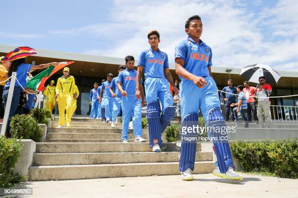 Captain Prithvi Shaw of India leads his team onto the field during the ICC U19 Cricket World Cup match between India and Australia at Bay Oval on...