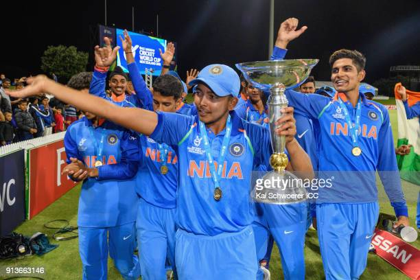 Captain Prithvi Shaw of India lifts the trophy after the win in the ICC U19 Cricket World Cup Final match between Australia and India at Bay Oval on...