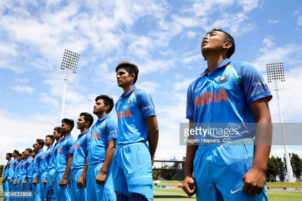 Captain Prithvi Shaw of India looks to the sky as the national anthem plays during the ICC U19 Cricket World Cup match between India and Australia at...