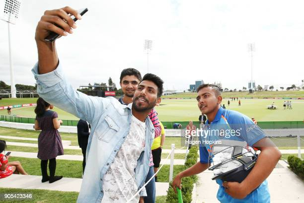 Captain Prithvi Shaw of India poses for a photo with fans during the ICC U19 Cricket World Cup match between India and Papua New Guinea at Bay Oval...