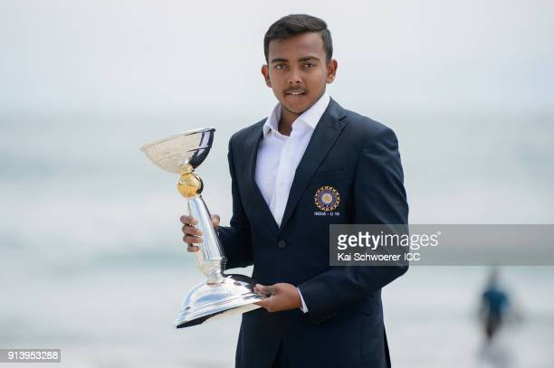 Captain Prithvi Shaw of India poses with the trophy during the ICC U19 Cricket World Cup media opportunity at Mount Maunganui Beach on February 4...