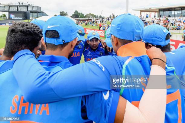 Captain Prithvi Shaw of India speaks to his team mates prior to the ICC U19 Cricket World Cup Final match between Australia and India at Bay Oval on...