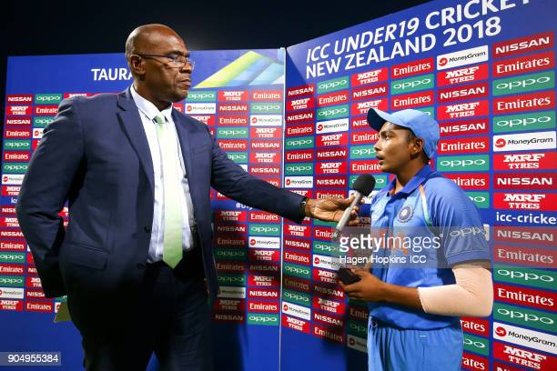 Captain Prithvi Shaw of India talks to presenter Ian Bishop during the ICC U19 Cricket World Cup match between India and Australia at Bay Oval on...