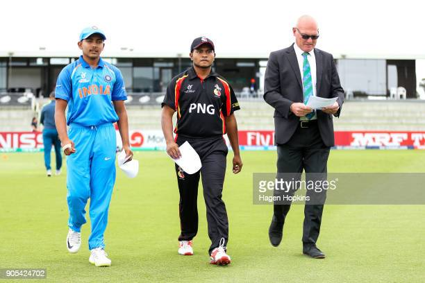 Captain Prithvi Shaw of India Vagi Karaho of Papua New Guinea and match referee Jeff Crowe walk to the coin toss during the ICC U19 Cricket World Cup...